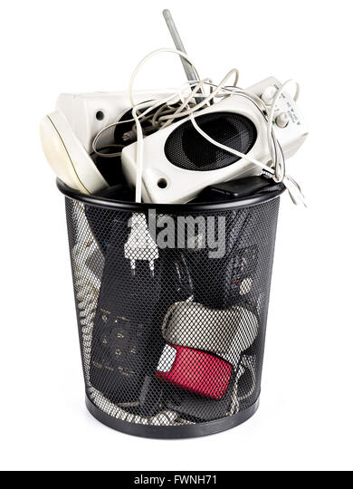 Metal bin full of used electronic garbage on white background - Stock Image