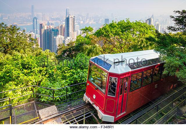 The Peak Tramway arriving at Peak Tower Station, Victoria Peak, Hong Kong - Stock Image