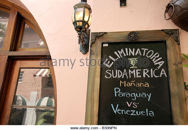 Miami Beach Florida Espanola Way blackboard announcement sign soccer Paraguay versus Venezuela Spanish language - Stock Image