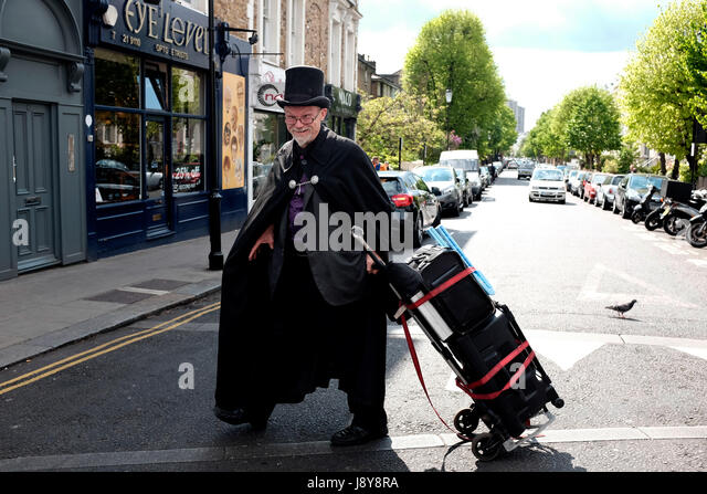 Traveling magician, Notting Hill, London, England, UK. - Stock Image