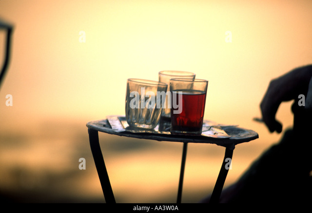 An abstract photograph of a glass of tea in one of many outdoor cafes in Cairo Egypt - Stock Image