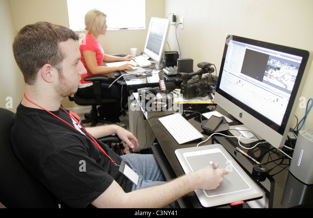 Plant City Florida Florida Strawberry Festival FOCUS TV man woman computer monitor graphics tablet electronic pad - Stock Image