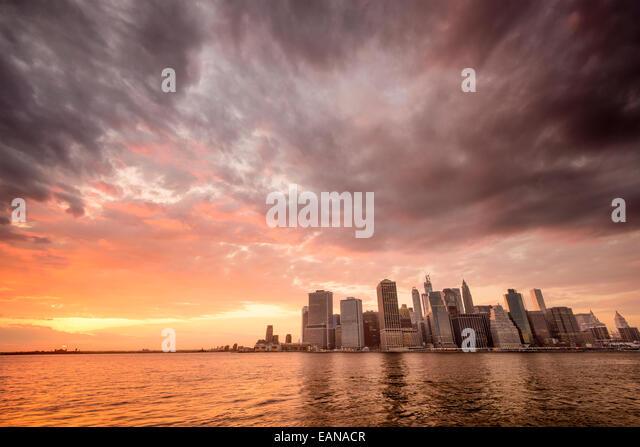 New York City, USA city skyline of Lower Manhattan at sunset. - Stock Image
