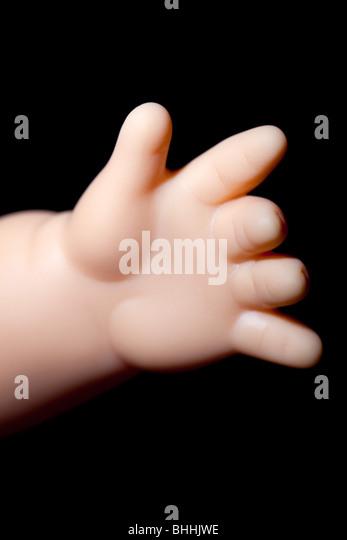 dolls hand - Stock-Bilder