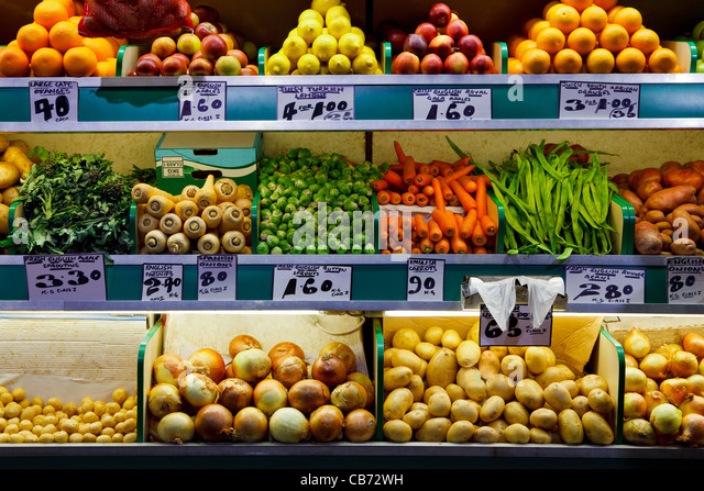 Photo of fresh organic fruit and vegetables on a farmers market stall. - Stock Image
