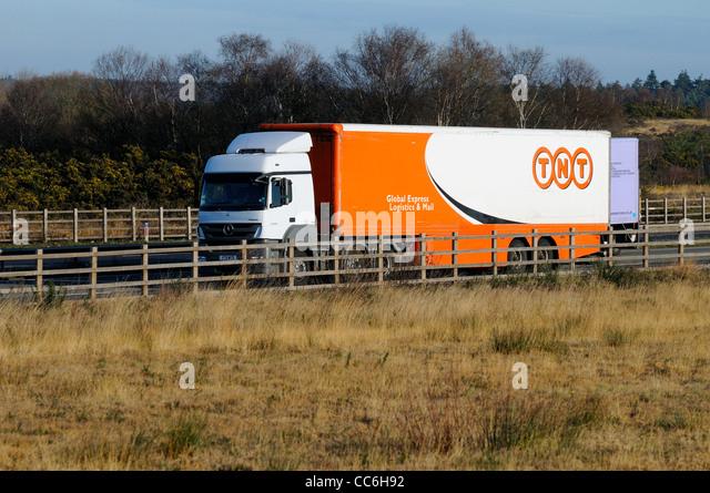 Speeding TNT delivery lorry on motorway - Stock Image
