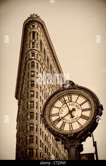 Flatiron building, 5th Avenue Clock, Sepia, New York - Stock Image