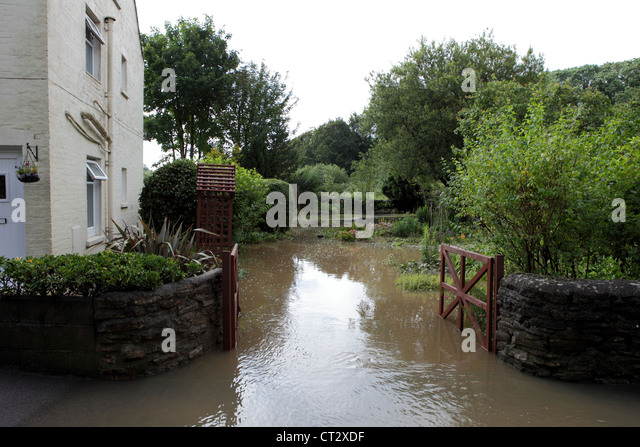 House and garden in Radipole Lane in Weymouth gets flooded after torrential rainfall - Stock Image