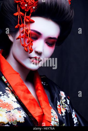 young pretty geisha in kimono - Stock Image