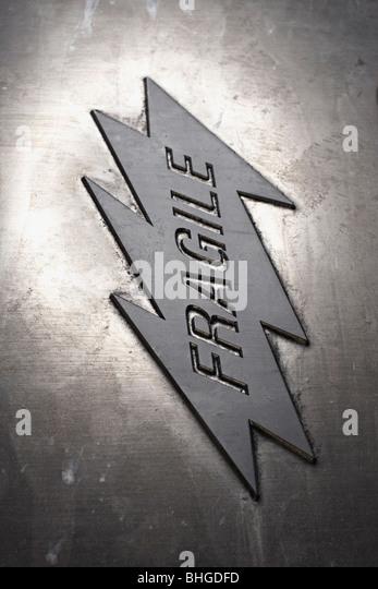 A sign regarding fragile material. - Stock Image