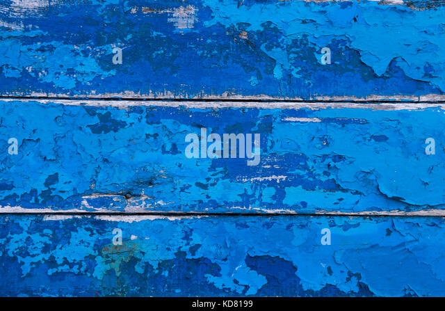 Crackled painted wooden fishing boat hull - Stock Image