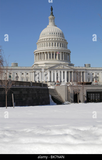 Washington DC Capitol Hill Historic District United States US Capitol snow winter dome government Congress symbol - Stock Image