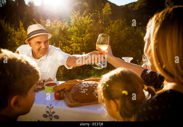 Family having a picnic in the garden, Munich, Bavaria, Germany - Stock Image