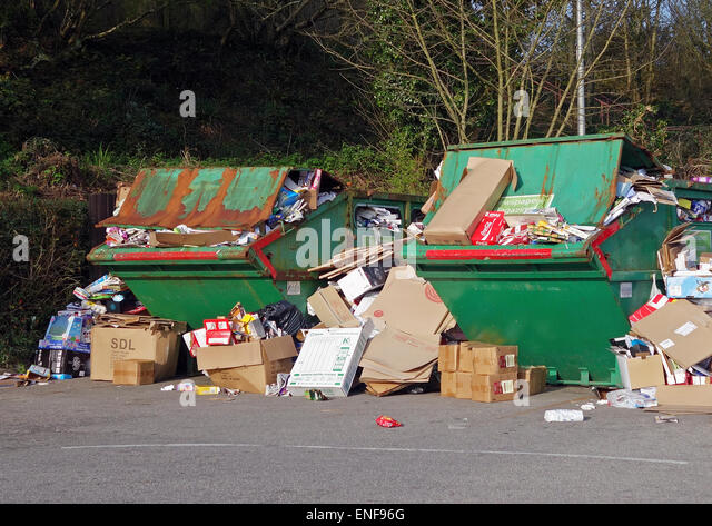 Overflowing recycling skips - Stock Image
