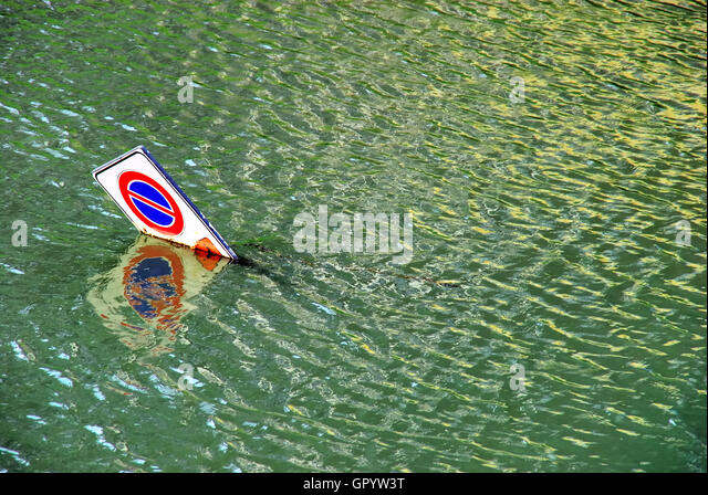 Padua, Italy. A traffic signal launched into the Piovego river. - Stock Image