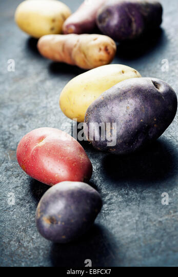 Mixed varieties of fresh potatoes - Stock Image