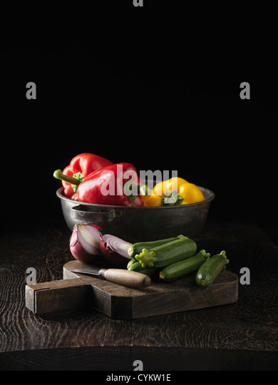 Cucumbers, onion and bell peppers - Stock Image