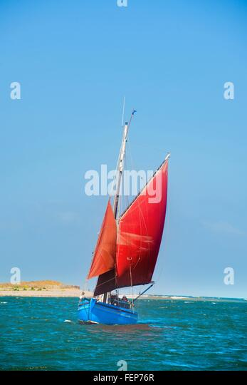 Sailing boat on water - Stock Image