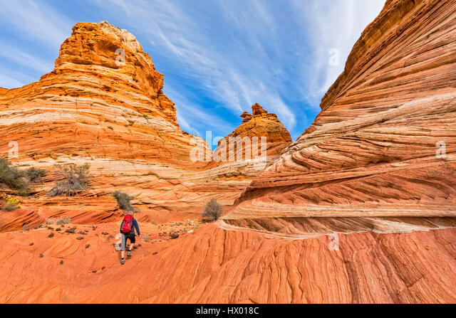 USA, Arizona, Page, Paria Canyon, Vermillion Cliffs Wilderness, Coyote Buttes, tourist hiking at red stone pyramids - Stock Image