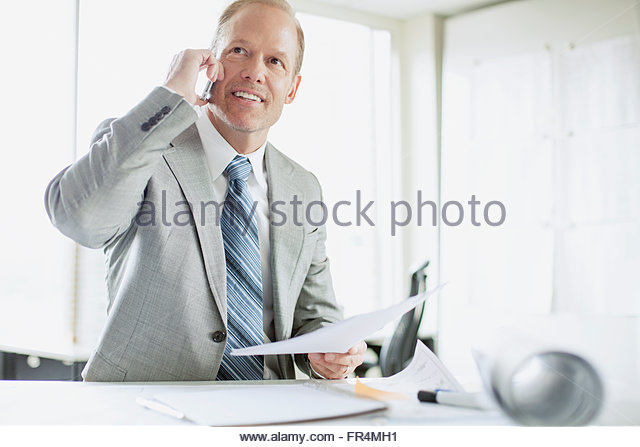 well-dressed businessman on a phone call - Stock Image