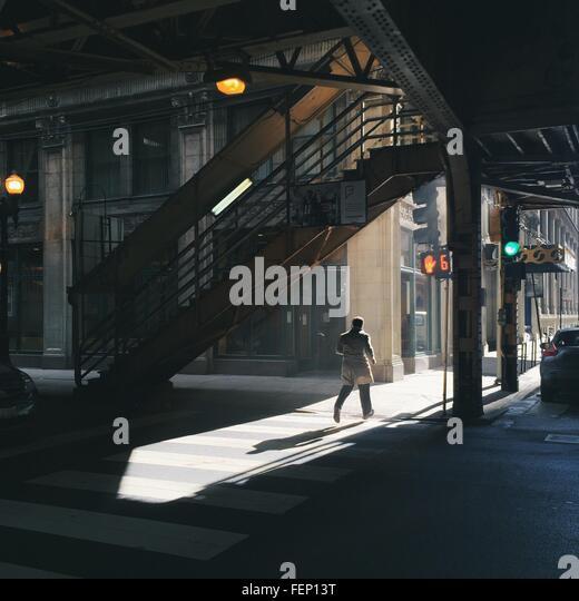 Man Walking In City Street - Stock Image
