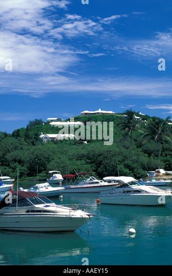 Bermuda Hamilton Harbour marina white motorboats at anchor - Stock Image