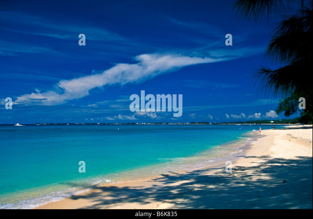 Seven Mile Beach early morning almost deserted no people Grand Cayman Island bright colors - Stock Image