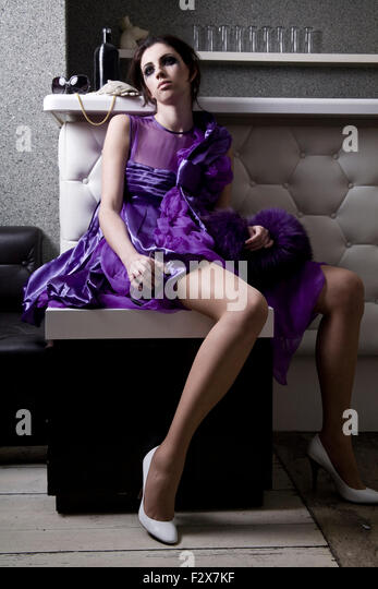 Disappointed young woman in purple evening dress - Stock Image