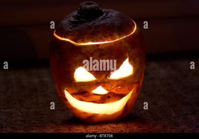 illuminated halloween turnip jack-o-lantern outside a house to ward off evil spirits. Traditionally in Ireland turnips - Stock Image