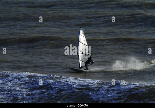 Wind surfing off Eastbourne, East Sussex, England. - Stock Image