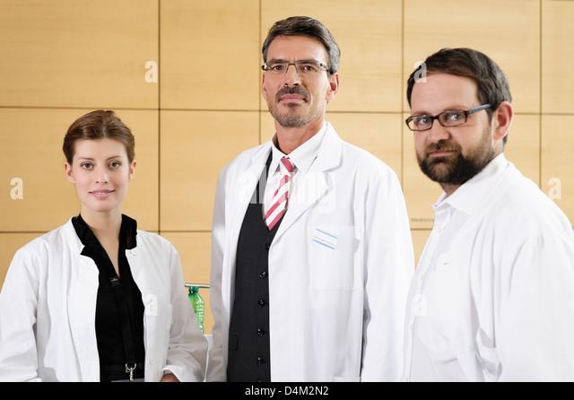 Doctors smiling together - Stock Image