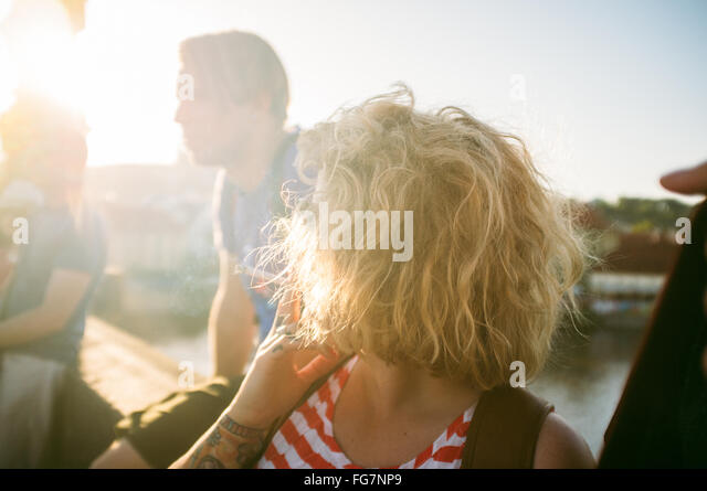 High Angle View Of Woman Smoking Cigarette On Sunny Day - Stock Image