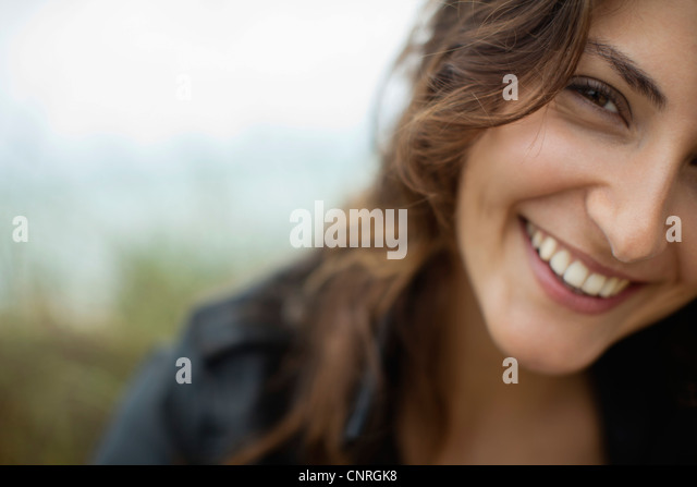 Smiling young woman, cropped - Stock Image
