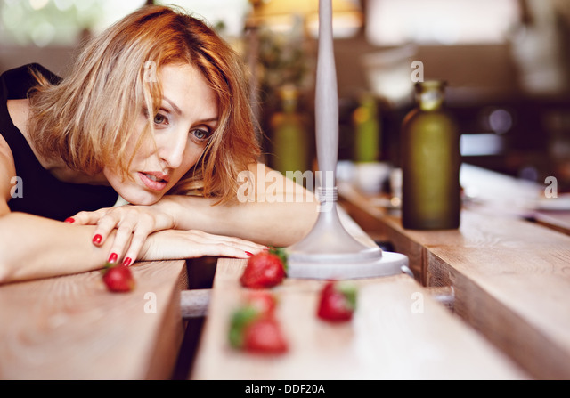 Girl with strawberries - Stock Image