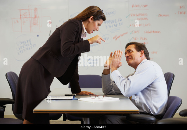 Businesswoman shouting at colleague - Stock Image