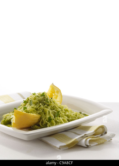 Spaghetti squash pesto on a white plate - Stock Image