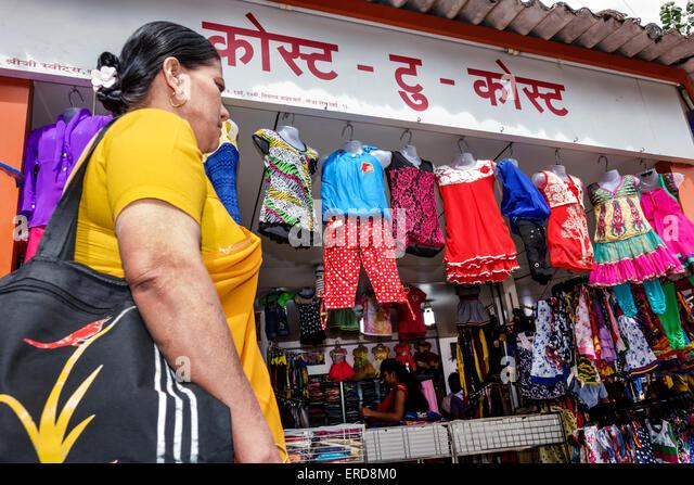 Mumbai India Asian Lower Parel Sunday Market shopping selling sale woman Hindi children's clothing store business - Stock Image