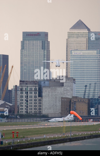 Regional turboprop aeroplane takeing off with strong crosswind from London City Airport UK - Stock Image