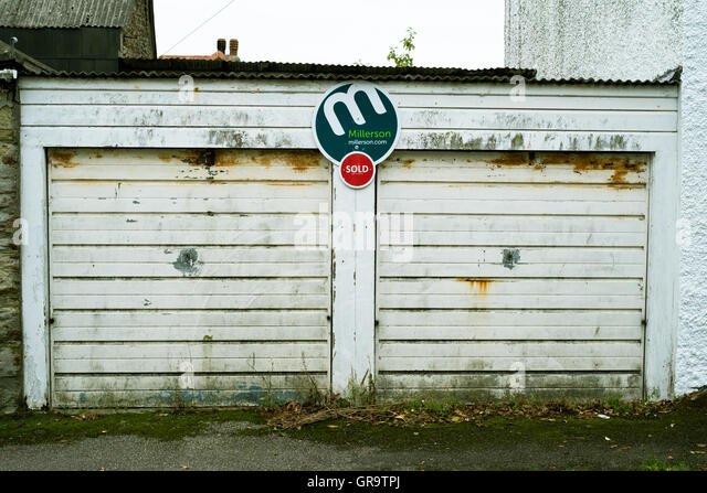 Pair of lock up car garages sold in Falmouth, Cornwall. - Stock Image