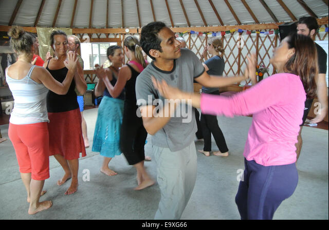 adults attend early morning dance workshop at Esalen Institue - Stock Image