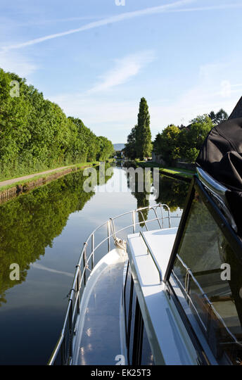 Boating on the Canal du Centre on a placid summer's day, Burgundy, France - Stock Image
