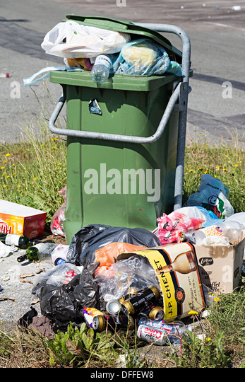 Rubbish overflowing from roadside bin at motorway services, Belgium - Stock Image