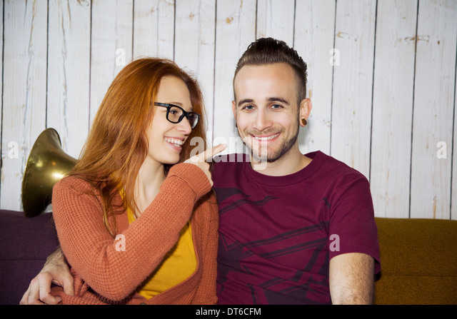Candid portrait of young couple - Stock Image