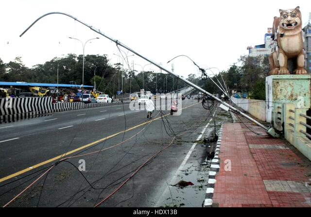 Street lamp post that came in the path of Cyclone Vardah, lie uprooted in Chennai, India on December 13, 2016. - Stock-Bilder