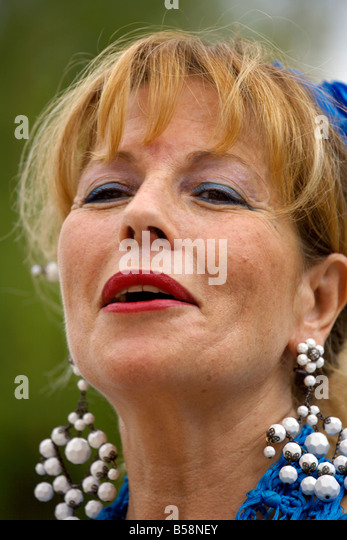 Portrait of beautiful blond middle aged Spanish woman in traditional costume, Fuengirola Feria, Andalucia, Costa - Stock Image