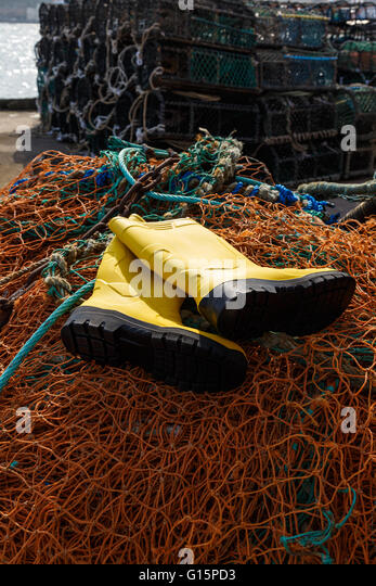 Foul weather gear stock photos foul weather gear stock for Commercial fishing boots