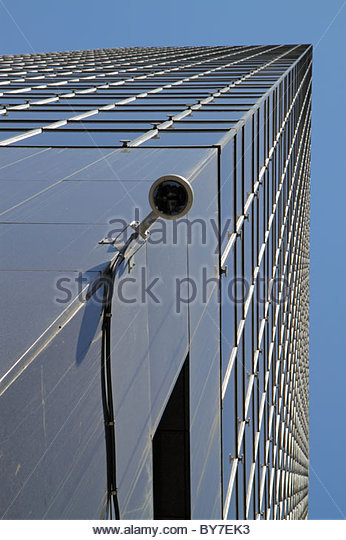 Baltimore Maryland skyscraper building perspective looking up vertical lines security camera video surveillance - Stock Image