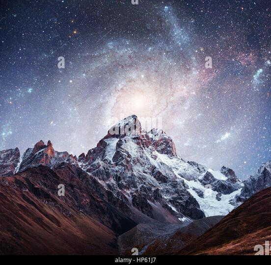 Fantastic starry sky. Snow-capped peaks. Main Caucasian Ridge. C - Stock Image