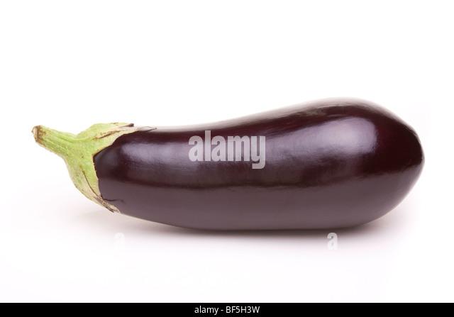 Large dark shiny purple Aubergine isolated against white background. - Stock Image