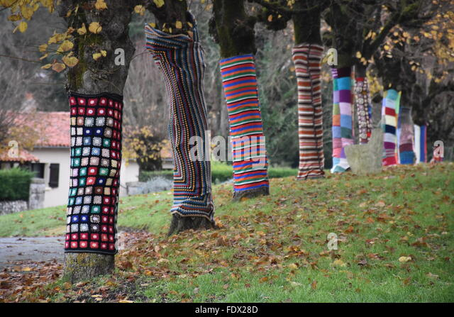 Decorated trees beside the Eglise de Charroux (Charroux church) Vienne (86) France - Stock Image